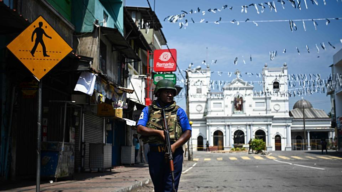 A security personnel stands guard near St. Anthonys Shrine in Colombo on April 24, 2019, three days after a series of bomb blasts targeting churches and luxury hotels in Sri Lanka. Photo by AFP