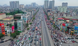 Mass outbound migration chokes roads in Hanoi, Saigon