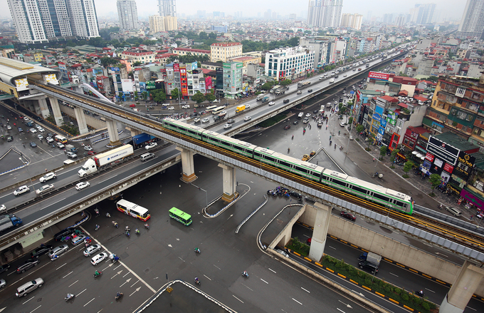 An aerial view of a train running above a flyover. Photo by VnExpress/Giang Huy
