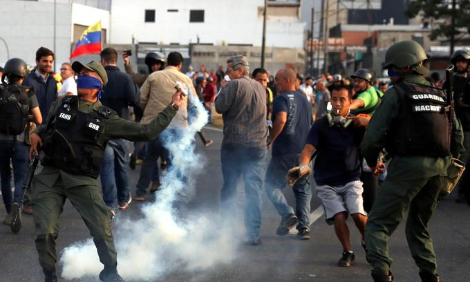 Venezuela's Guaido urges troops to rise, mass protests planned