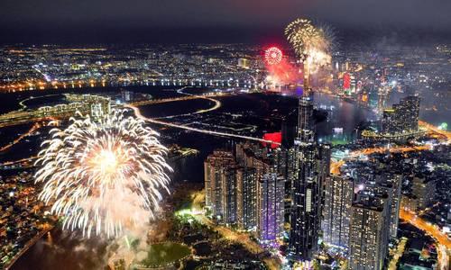 Saigon skyline dazzles to celebrate two historic days