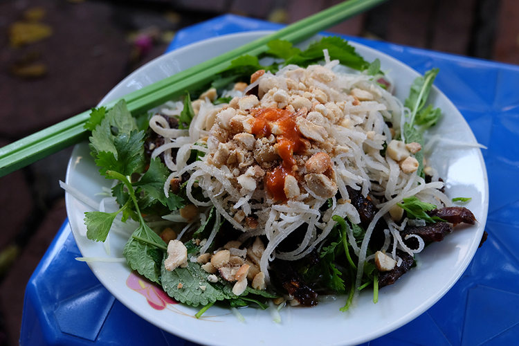Many Old Quarter stalls in Hanoi serve the Vietnamese beef jerky salad.