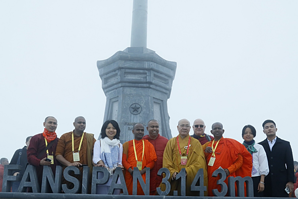On the occasion of the Buddha's birthday, international delegates make a special pilgrimage to the peak of Fansipan
