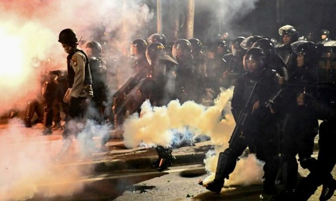 Indonesian police fire tear gas to break up election protest