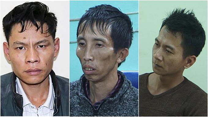 Vi Van Toan (L), Bui Van Cong and Vuong Van Hung at the polices office.