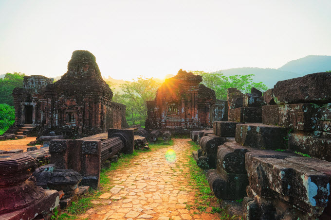 Sunrise at the My Son Sanctuary in Quang Nam Province, a complex of abandoned and partly ruined Hindu temples. Photo by Shutterstock/Huy Thoai