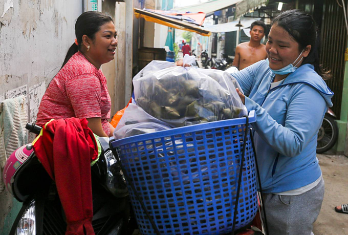 Saigon hamlet makes rice cakes for cleansing body and spirit - 11