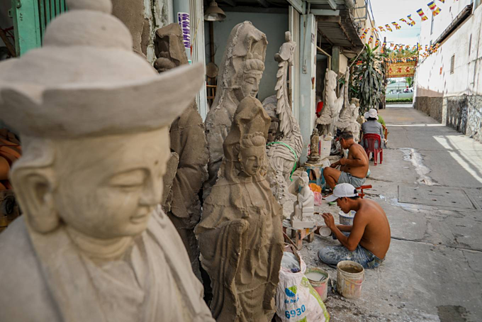 Crafting Buddha idols in Saigon