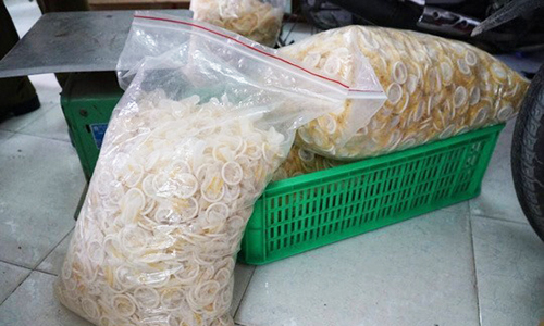 Saigon detains four men running fake condoms factory