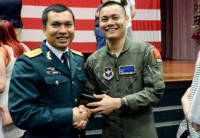 Vietnams Senior Lieutenant Dang Duc Toai (L) and Sublieutenant Doan Van Canh at the ceremony that sees Toai graduating from the U.S. aviation leadership program. Photo by USAF
