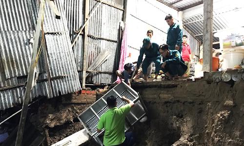 Riverside erosion sinks eight Mekong Delta houses