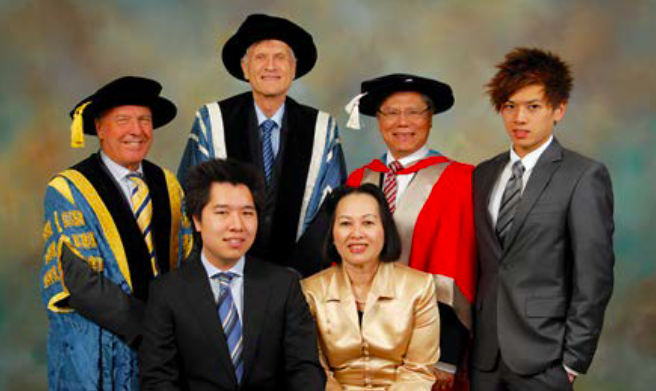 Hieu Van Le (R, 2nd) with his wife and sons after receiving his honorary doctorate in 2008. Photo provided by Hieu Van Le.
