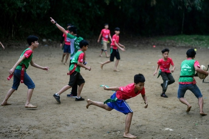 The players are barefoot and train on a makeshift pitch. Photo by AFP/Manan Vatsyayana.