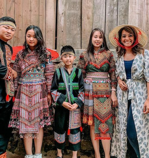 .Fatima Al-Mattar wearning non la, or conical hats poses for a photo with people from ethnic minority groups during a trip to Sa Pa in the northern highlands. Photo courtesy of Fatima Al-Mattar