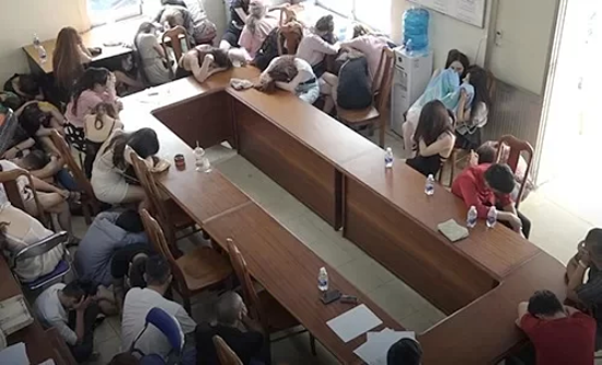 Several people from the 030-X8 bar in Saigon are taken to the police station July 24, 2019. Photo by VnExpress.