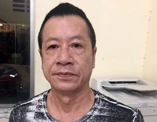 Vietnamese American Le Van Tien is held at a police station for organizing illegal use of drug at his bar in Saigon on July 28, 2019. Photo courtesy of HCMC Police.