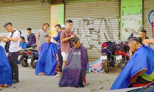 Barbers give back to society with free haircuts