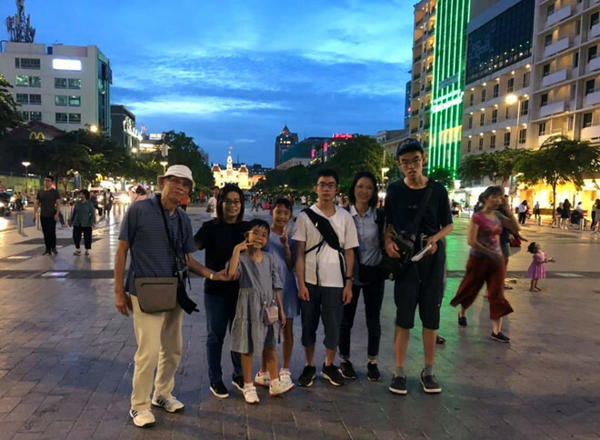 Oki Toshiyuki (leftmost) with his family at the Nguyen Hue Walking Street in Saigons District 1. Photo courtesy of Oki Toshiyuki.