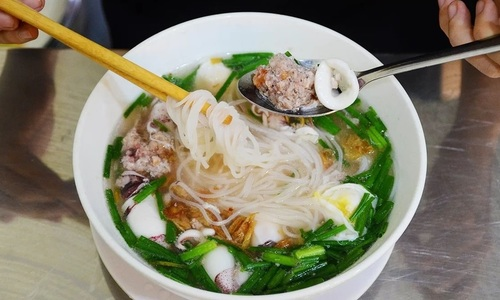 Squid noodles keep a Saigon shop busy all day
