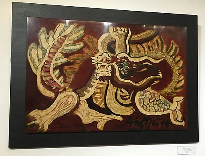 The lacquer painting titled Rong (Dragon) showed at the Paintings Returning from Europe exhibition. Photo by VnExpress/Thoai Ha.