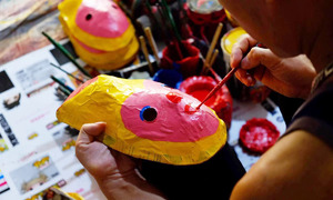 Northern village making masks and drums for Mid Autumn Festival