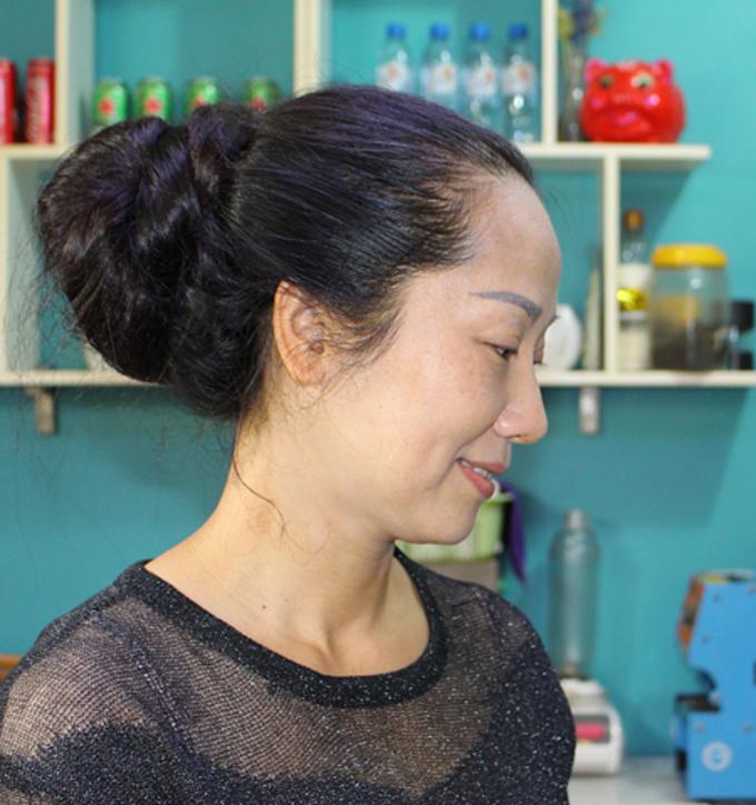 Lan with her tied up hair. Photo by VnExpress/Pham Nga.