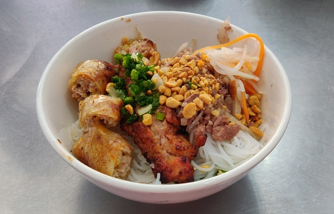 A bowl of bun thit nuong cha gio served at Chi Tuyen restaurant at 175 Co Giang, District 1, HCMC. Photo by Nafi Wernsing.
