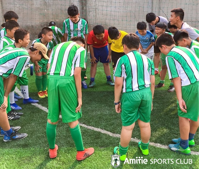 Children take a bowl after a training session with Amitie in Ho Chi Minh City, March 2019. Photo courtesy of Amitie Sports Club.