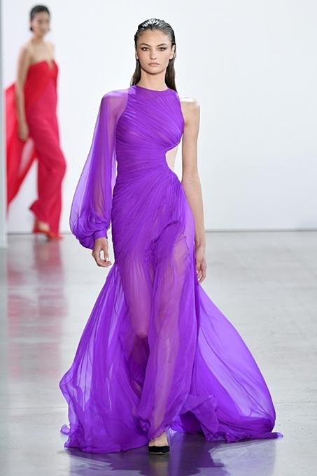 A sexy one sleeve dress with a side hip cutout.