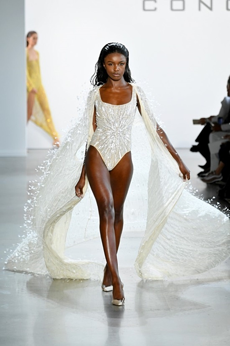 English model Leomie Anderson walked in a sequin bodysuit ornamented with crystal stones.