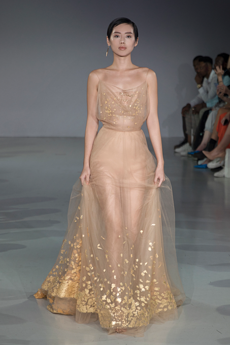 The sheer dress ornamented with rich gold at the end of the show.