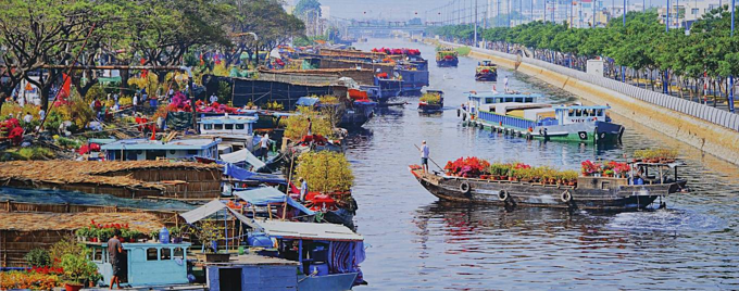 Merchants from Mekong Delta stack their boats with fresh flower at Binh Dong port in District 8 for the occasion of Lunar New Year when every house fancies spring flowers. The picture was taken in 2015.