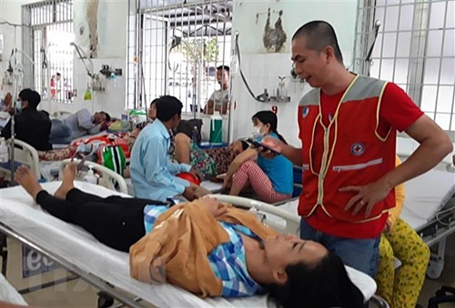Tran Thi Tuyet Mai is taken to Tay Ninh General Hospital after being physically abused by her husband. Photo by Vietnam News Agency/Le Duc Hoanh.