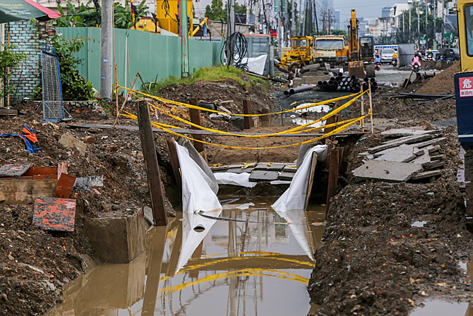 Sections of the road drainage sewer has poor barrier and become deep holes filled with water when raining.