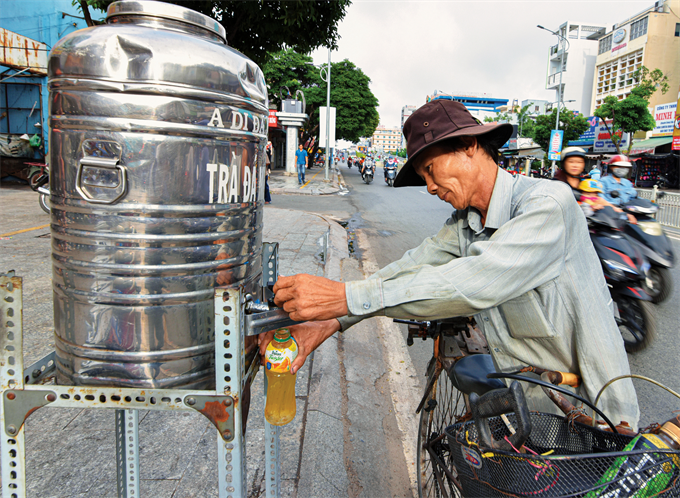 The care and concern of Saigon residents for others can be seen on many streets where water containers offer free iced tea for parched throats.