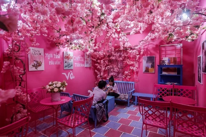 One of the café's rooms continues the pink-purple-blue combination with a profusion of pink and white artificial blooms.  The chairs had to be custom made because I cannot find them on the market. These are the type of chairs they use in Mediterranean bars, Tuan said.