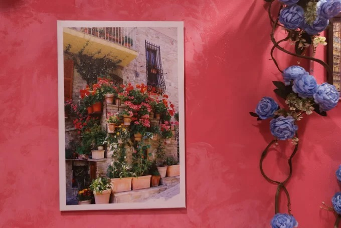 The café's walls sport photos of houses in countries like Greece and France.