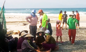 One student drowns, another missing in central Vietnam beach accident