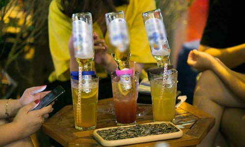 Overturned beer bottle in mojito, Hanoi's new nightly fix