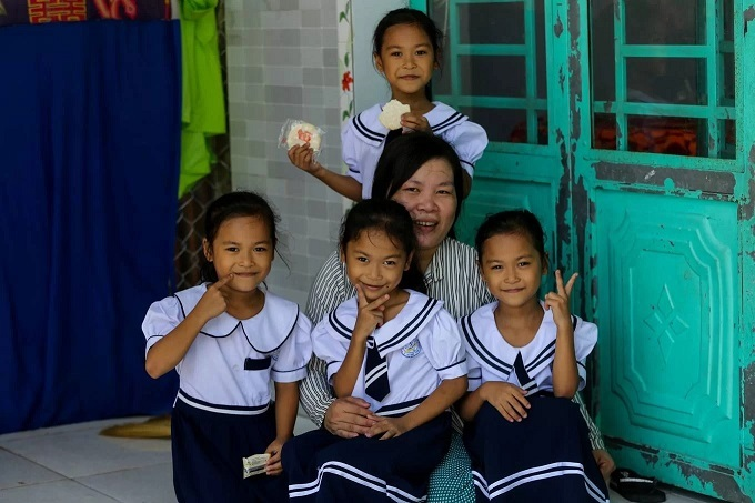 Tran Thi Tinh with her daughters: Tran Thi Minh Hanh, Tran Thi Minh Nam, Tran Thi Minh Phuc, and Tran Thi Minh Viet at their home in Dong Thap Province. Together, their first names form the phrase Viet Nam Hanh Phuc which means Happy Vietnam.Tinh gave birth to the quadruplets in 2012. This phenomenon occurs naturally once in 700,000 births. They were named by doctors at the Tu Du Hospital in Ho Chi Minh city. They are meaningful names, so our family kept them, Tinh said.