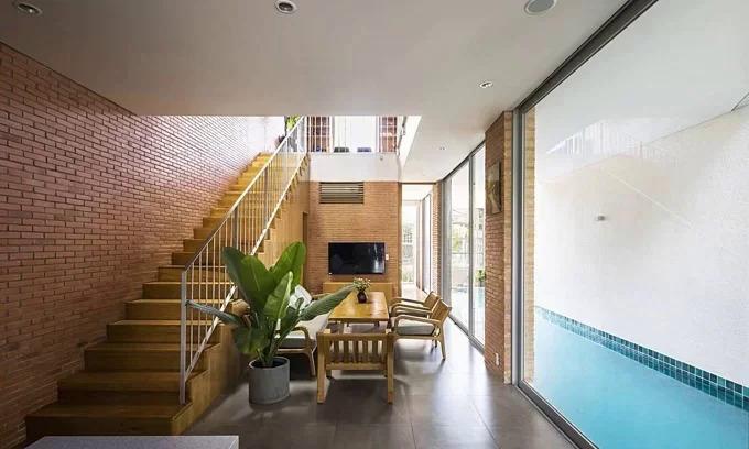 The Ha House has a swimming pool inside the living room. Photo by Hiroyuki Oki.