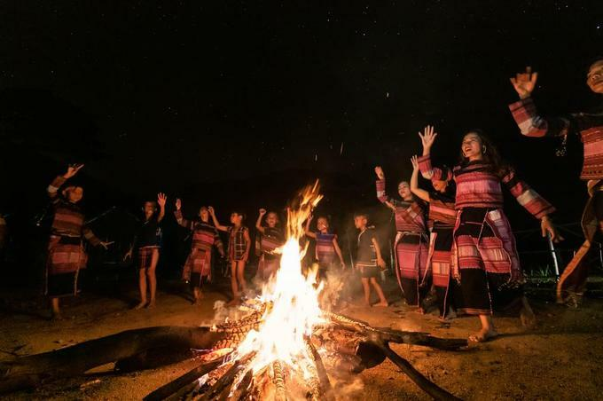 Ba Na peope perfom traditional dance around fire during Dak Po Districts night gong festival.