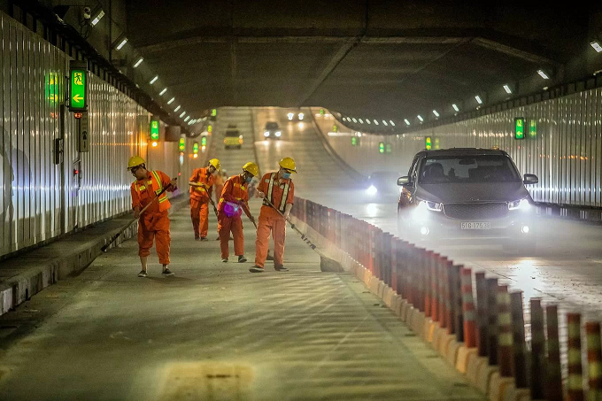 The Saigon River Tunnel, known formerly as Thu Thiem Tunnel, opened to traffic in November 2011, connecting downtown District 1 with District 2, a favored residential area by many expats.The tunnel lies 27 meters under the Saigon River at its deepest point as it runs 1.49 kilometers (less than a mile) long from one end to another. It is 33 meters wide and nine meters high with six lanes, apart from two emergency exit lanes.In order for the tunnel to serve traffic from 3 a.m. until 11 p.m. every day, a team of nearly 70 Vietnamese engineers and workers engage in maintenance work every night after it shuts down to traffic.