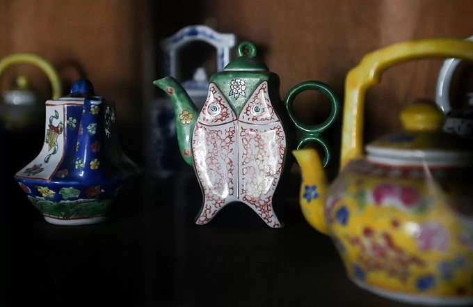 A set of teapot, dishes, cups that is about as old as the house itself is still in the cupboard.