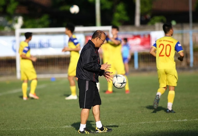Coach Park throw balls to help his student practice. The win against Malaysia last Thursday has more or less reduced the pressure on him, Park said.