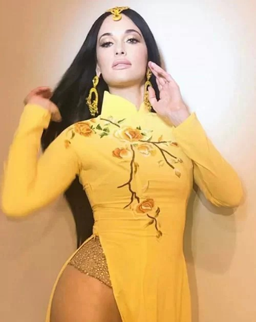 On October 12th, American Singer Kacey Musgraves stirred great controversy within Vietnamese communities worldwide, and not for good reasons. Wearing traditional Vietnamese ao dai yet intentionally replacing the pant with a transparent stocking, the singer posed in overtly sexy manner. The pictures infuriated Vietnamese and they accused her of not respecting Vietnamese traditions. Many local celebrities such as producer Ngo Thanh Van and model Pham Huong also expressed their frustration.