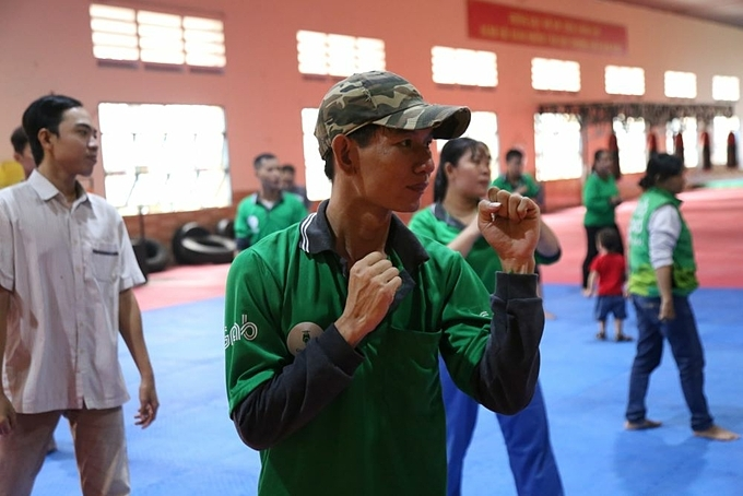 GrabBike drivers join a martial arts class to increase self-defense skills in Ho Chi Minh City. Photo by Thu An.