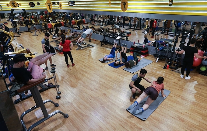 Local residents keep fit  at a gym in Saigon's District 3. Photo by VnExpress/Quynh Tran.