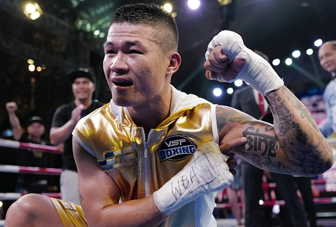 Hoang celebrates his win, pointing at his King tattoo on his left arm.