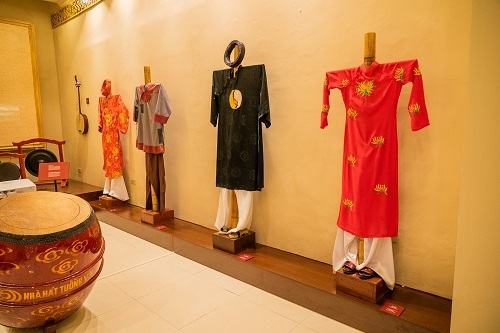 Traditional costumes on display at the exhibition Behind the Mask.